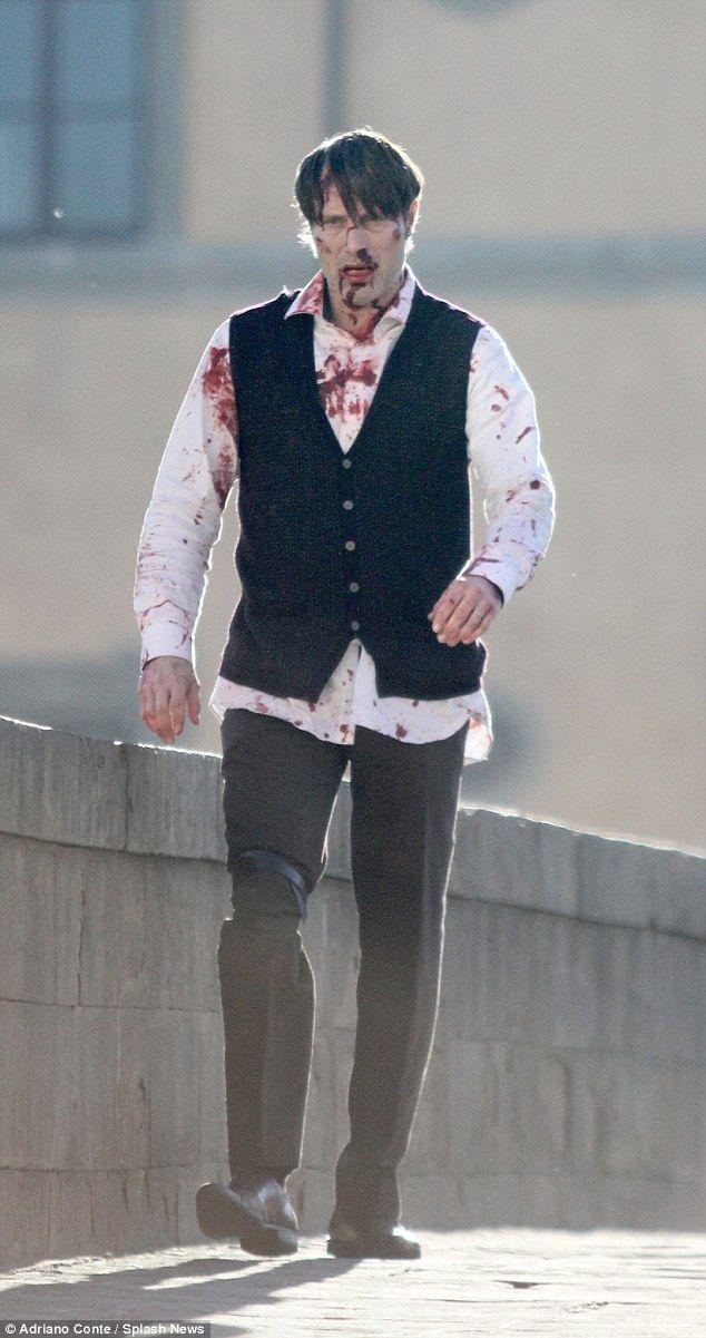 A bloody sight:Mads Mikkelsen was back as serial killer Hannibal Lecter as he filmed scen...