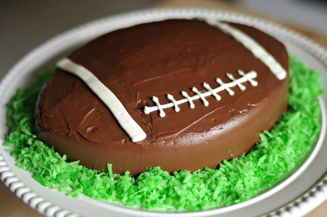 Cut a 2 inch strip out of the middle of a 10 inch round cake to make a football shape.