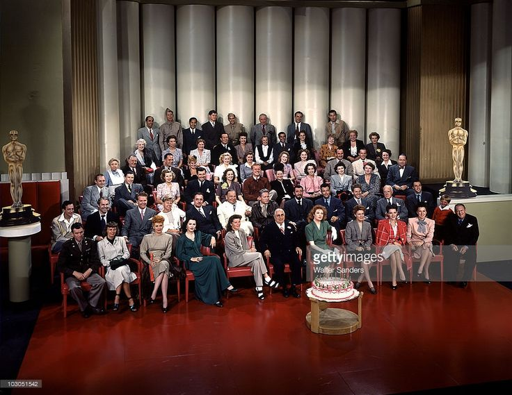 Portrait of Polish-born American film executive and studio head Louis B. Mayer (1885 - 1957) (front row, center, in black suit and eyeglasses), as he poses for a group portrait with movie stars and others at his MGM Studios (Metro Goldwyn Mayer) 20th anniversary, Hollywood, California, 1943. Among those pictured are, front row, from left, James Stewart (1908 - 1997), Margaret Sullavan (1909 - 1960), Lucille Ball (1911 - 1989), Hedy Lamarr (1914 - 2000), Katharine Hepburn (1907 - 2003)…