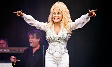 Glastonbury 2014: Dolly Parton lifts rain-soaked festival to sunnier climax