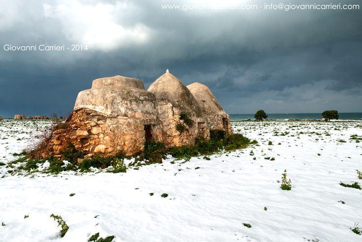 Trulli, snow and sea. A rare combination - Polignano a Mare #trulli #apulia #wintersea