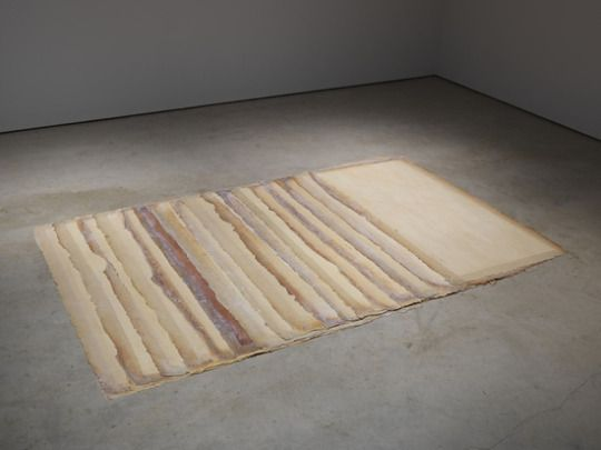 Eva Hesse, Augment, 1968. Latex and canvas, installation variable: 17 units, each 78 x 40 inches. Private Collection. © The Estate of Eva Hesse. Photograph by Genevieve Hanson. Courtesy of Hauser Wirth & Schimmel.