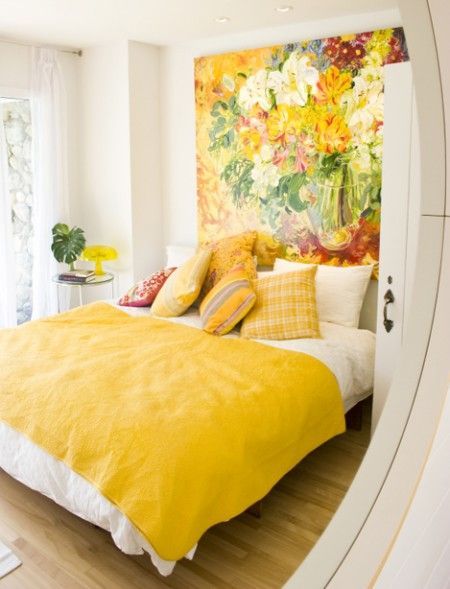 Large painting serving as a headboard and yellow colour. Get inspired by yellow at http://insplosion.com/inspirations