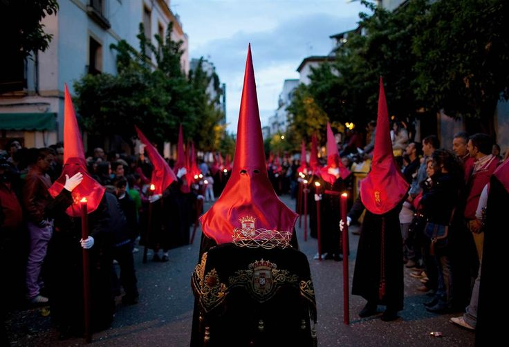 Penitents of the Caridad brotherhood walk the streets during the Holy Week procession on Thursday in Cordoba, Spain. Many towns in Spain celebrate Easter week with processions.