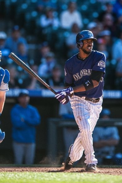 Dexter Fowler 24 Of The Colorado Rockies Hits What Would Be The Game Winning Rbi Single In The 10th Inning Of A Game Against The Los Angeles Dodgers At Coors F