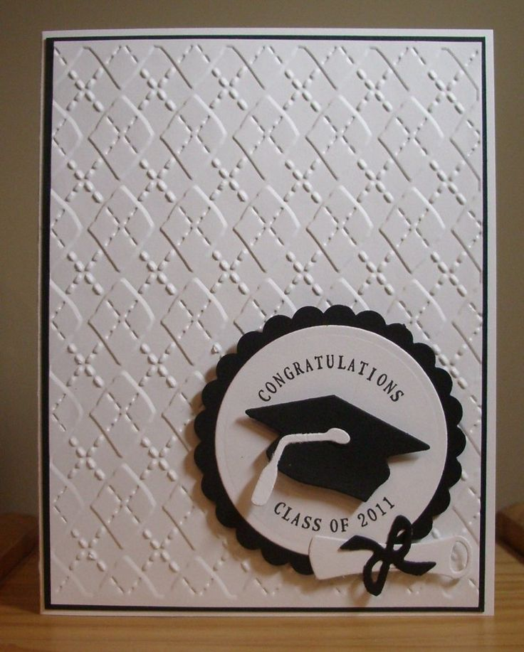 Lifestyle Crafts die cuts are used for the graduation cap and tassel on this handmade card.  Black and white layers with argyle embossing.