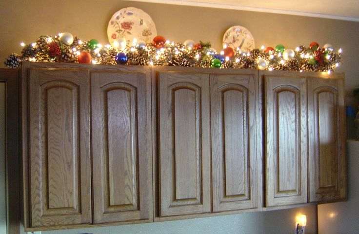 Christmas Cabinet Top Decorating