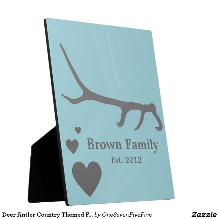 Deer Antler Country Themed Family Name Plaque Display that special moment in a unique way with this plaque. Design features a single deer antler above several hearts. Two lines of text can be easily customized to include names, wedding dates, birth dates, or anything you desire! Background color can also be customized upon ordering. Plaque includes stand for easy display and comes in different sizes.