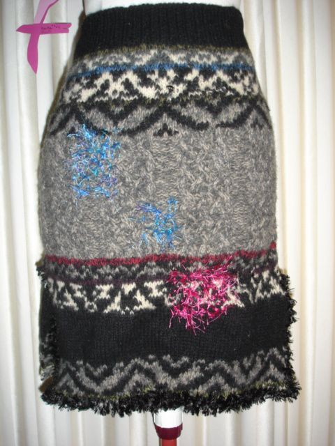Man's woollen jumper with many holes REscued from landfill and upcycled into a pencil skirt.