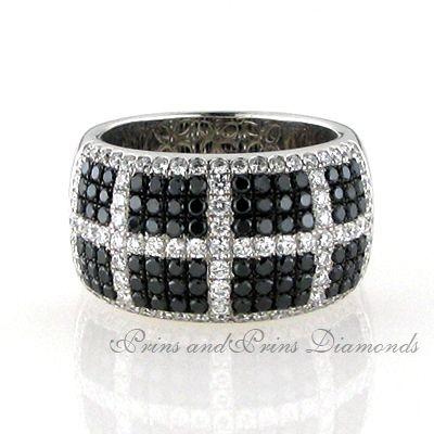 There are 84 = 1.15ct round black diamonds and 87 = 0.95ct GH/VS – SI round brilliant cut diamonds pavé set in an 18k white gold block design