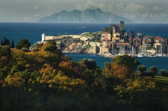 The village of #Talamone with the #island of #MonteCristo in the distance - Photo: sunnytuscanytours.it