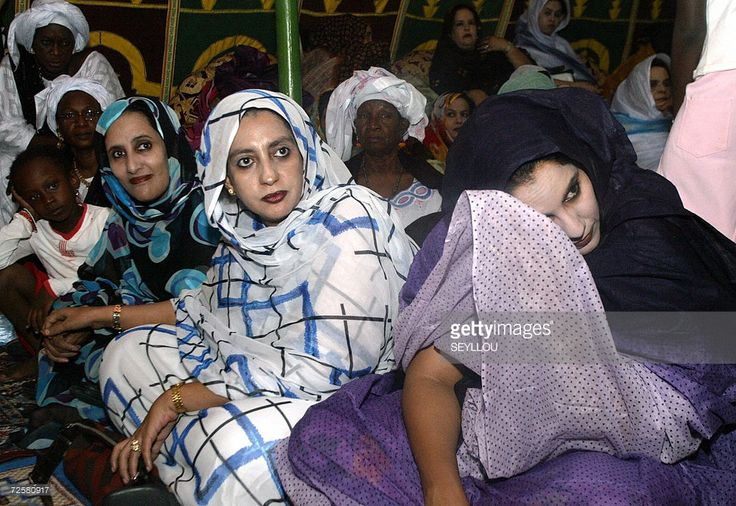 Mauritanian women, members of the Assembly of Democratic Forces, RFD, (Rassemblement des Forces Democratique) attend late 15 November 2006, a campaign meeting for the Municipal and Parliamentary elections due 19 November. Some 1,222 candidates including 888 from the political parties and 334 independents are involved in the two-week electioneering. About 444 candidates, including 260 running on the platform of political parties and 124 independents are in the race for the municipal seats.