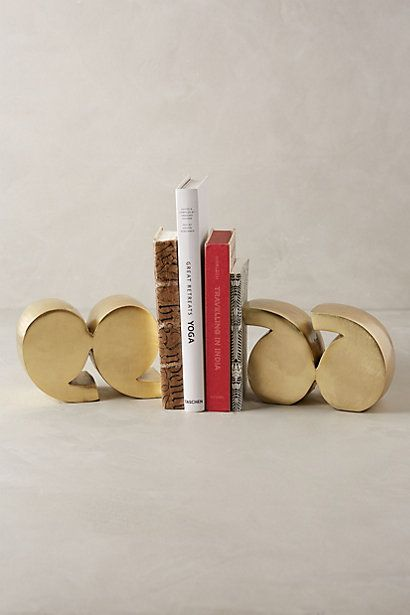 Quotation Mark Bookends for a statement making bookshelf! $168; Anthropologie.com | StyleCaster Holiday Wish List