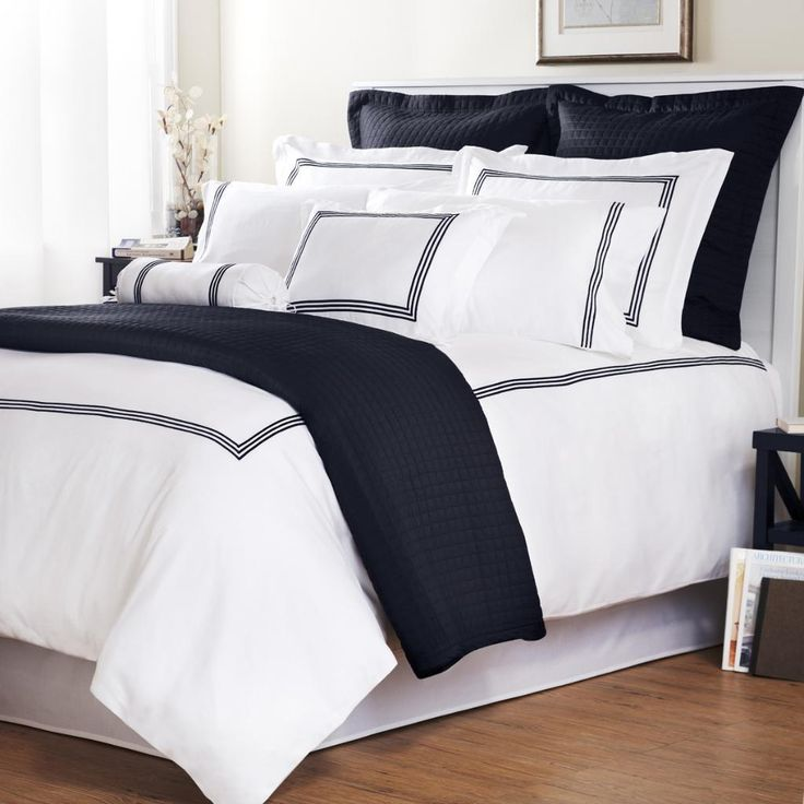 Tie the look of your bedroom together with this king-sized duvet cover set in a classic navy stripe pattern. This set is made of machine-washable cotton with a thread count of 300 for softness. It includes two shams in addition to the duvet cover.