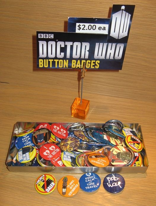 """Susan Says: Doctor Who button badges, $2 each. Loads to choose from - """"Keep Calm and Time Travel"""", """"I am not a Dalek"""" - like that. While you are stocking up - check out the Doctor Who puzzles and mugs.  Available at Best of Friends Gift Shop in the lobby of Winnipeg's Millennium Library. 204-947-0110 info@friendswpl.ca"""