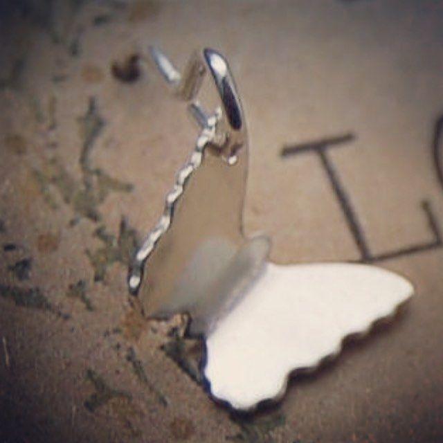 Simple silver dangly butterfly  earring http://ift.tt/2ry5mp9