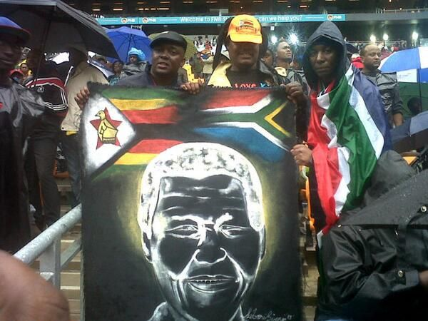 #MandelaMemorial Hundreds of people braved the cold rainy weather in Johannesburg's FNB Stadium on Tuesday 10 December 2013 to pay tribute to former president Nelson Mandela.