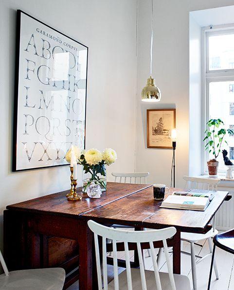Cozy white home with a fireplace - via Coco Lapine Design