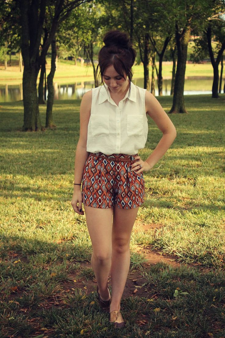 Patterned high waisted shorts and a neutral white top.