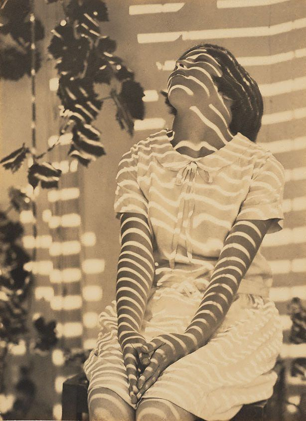 Harold Cazneaux. Pergola pattern, 1931 It makes me wonder what she's looking for...