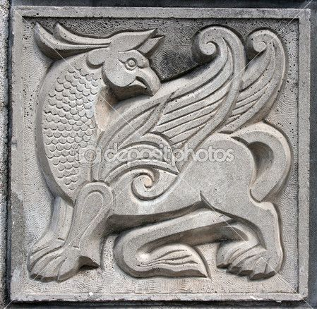 Old bas-relief of fairytale winged lion — Stock Photo #5763643