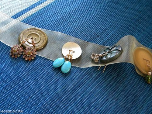 Put your earrings through buttons and a ribbon to keep them safe when traveling.        Gloucestershire Resource Centre http://www.grcltd.org/scrapstore/