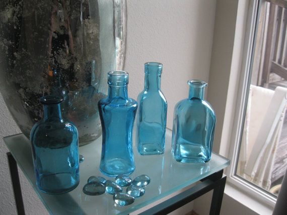 40 best glass images on pinterest colored glass colored for Colored bottles for decorations