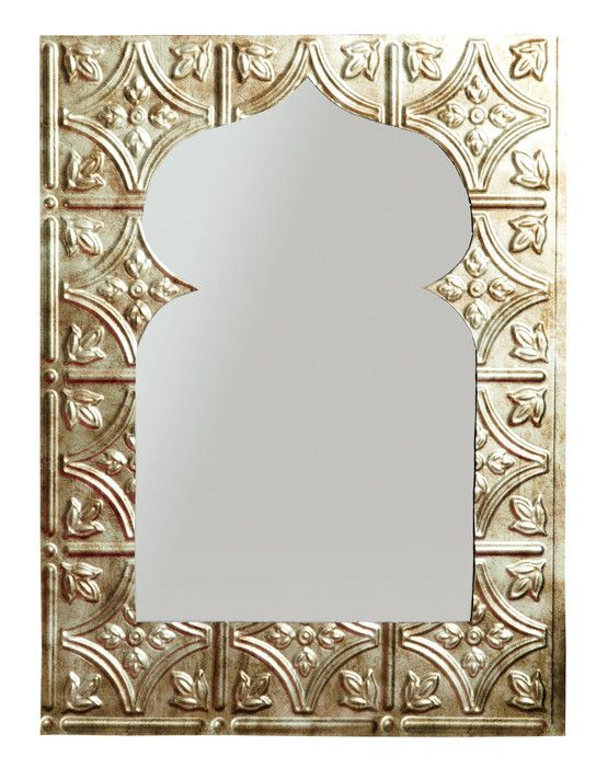 Spruce up your home decor with this eccentric mirror, which you can make yourself with a few simple materials.