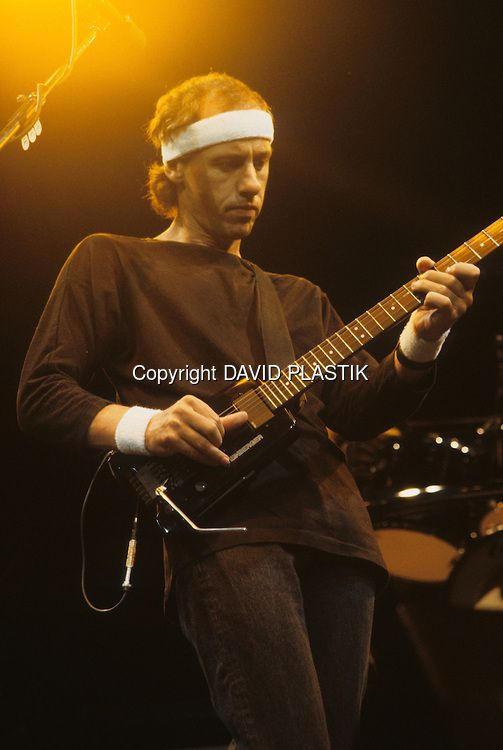 Mark Knopfler and Dire Straits.   Follow me Home.