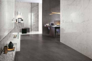 Gres porcellanato effetto pietra e superfici effetto marmo per living e home studio.