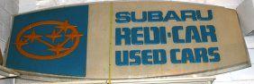 "SUBARU USED CAR SIGN : Lot 206    Embossed fiberglass; edge damage and discoloration; H-45"", L-113"""