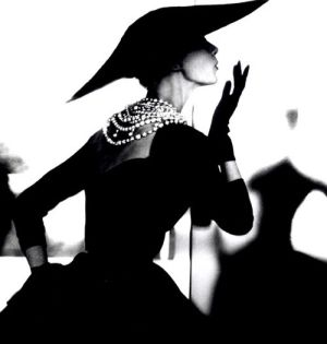 Vintage Chanel LBD with the timeless pearl necklace...fabulous fit ... & a wide brimmed hat.