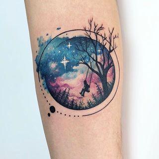 Swinging child galaxy background tattoo