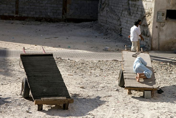 Sleeping porter on his cart near the Grand Mosque. Dubai.