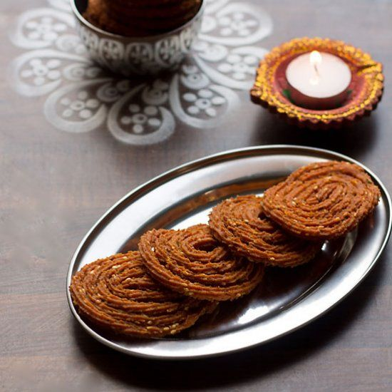 What are chaklis? They are crunchy, crispy spiral deep fried and made with refined flour. It's a savory snack made during Diwali by Maharash.  Bowl reflecting table design!