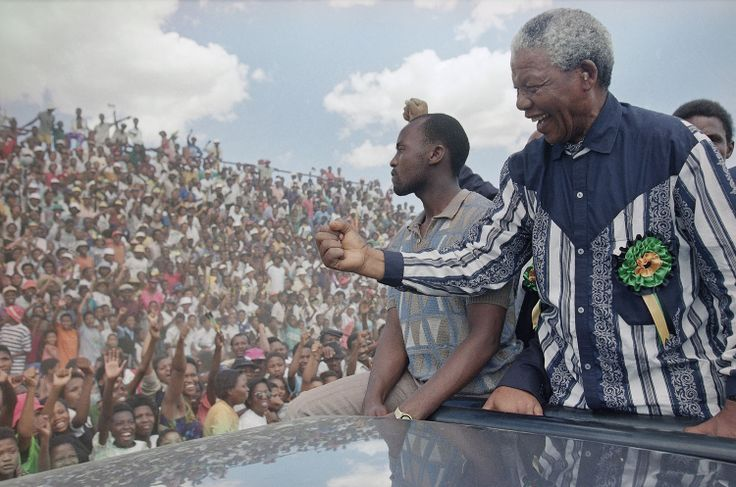 Mandela salutes the crowd in Galeshewe Stadium, near Kimberley, South Africa, on February 25, 1994, during a three-day campaign swing for the April all-race general election. Photograph by David Brauchli/AP.