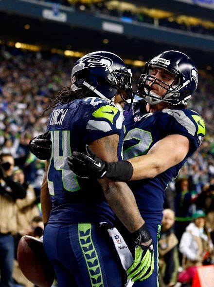 Running back Marshawn Lynch #24 of the Seattle Seahawks celebrates with tight end Luke Willson #82 after Lynch scores on a 40-yard touchdown against the San Francisco 49ers in the third quarter during the 2014 NFC Championship at CenturyLink Field on January 19, 2014 in Seattle, Washington. (Photo by Jonathan Ferrey/Getty Images)
