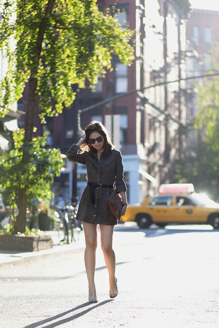 Adriana Gastélum wears khaki shirt dress with cute black belt; classic military style. Dress: Lulu's, Sunglasses: Karen Walker.