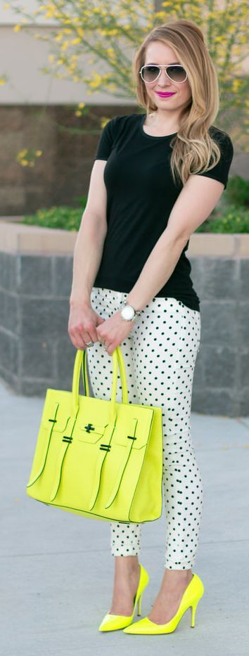 Black tee, white and black polka dot pants with neon accessories