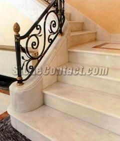 marble steps with wrought iron railing