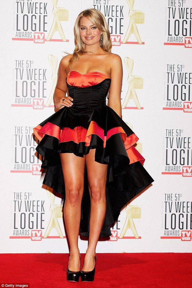 Bold move:In 2009, well before her Hollywood career took off, Neighbours star Margot Robbie stepped out in a dramatic black and red dress