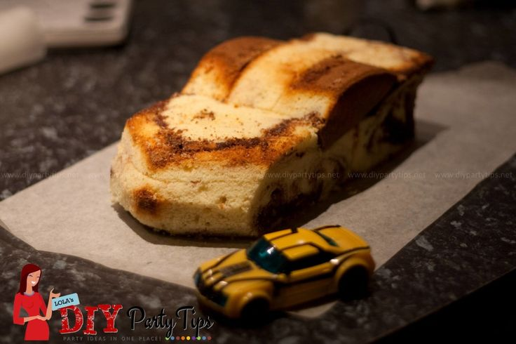 bumblebee transformer cake | little Transformer Bumblebee toy that we used as a model for the cake ...