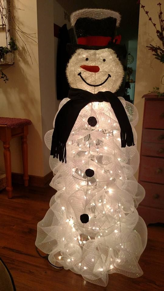 "Tomato Cage Snowman -SUPPLIES: For this snowman you will need: (2) 21""x10yd roll White Deco Mesh (1) Tomato cage - 5ft (2) White Christmas Lights 100-Light Craft Wire Wire Cutters & Scissors Snowman head which I purchased at Cracker Barrel"