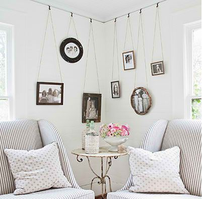 Hang photographs in various types of frames using molding    hooks and ribbon or string.