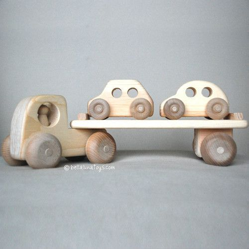 This handcrafted Car Carrier Wooden Toy Truck is made of thick native Maine white pine. Truck body connects to cab with a sturdy wooden peg, and cab has a removable driver. Truck length is approximate