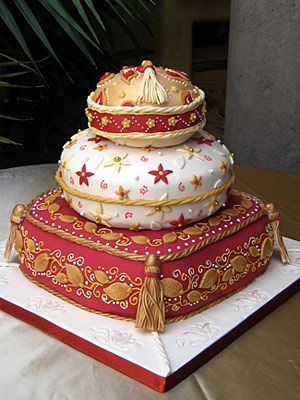 Two beautiful things are combined here: Moroccan pillows, and wedding cakes. It's actually a cake! WOW.