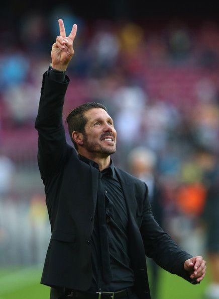 Diego Simeone the coach of Club Atletico de Madrid celebrates towards his supporters after winning the La Liga after the match between FC Barcelona and Club Atletico de Madrid at Camp Nou on May 17, 2014 in Barcelona, Catalonia.