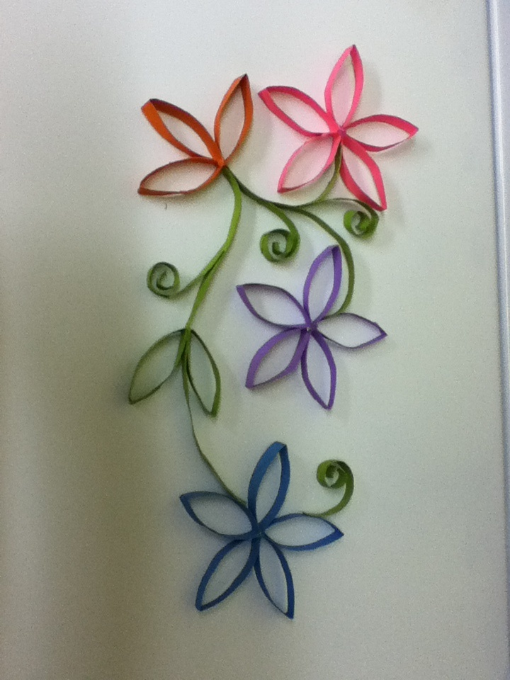 I made this flower decoration out of toilet paper rolls