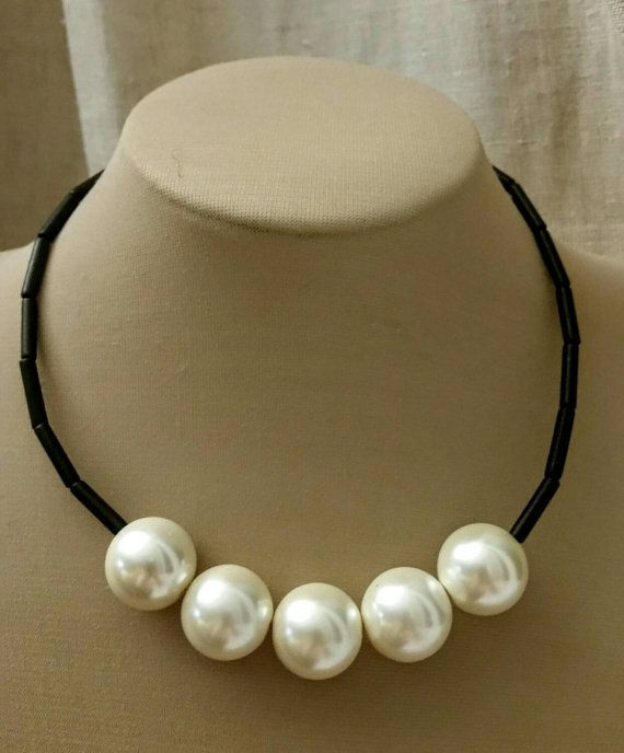 Check out this item in my Etsy shop https://www.etsy.com/ca/listing/245022566/trending-extra-large-pearl-choker-winter