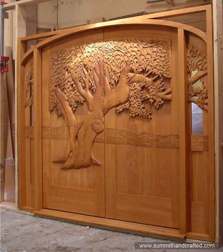 Hand carved entry door close the door pinterest the for Hand carved wood doors